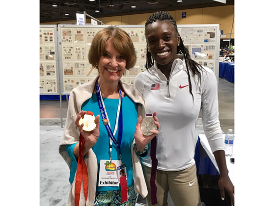 Pam checks out Dawn Harper Nelson's Olympic medals